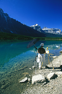 Tatianna O'Donnell painting beside Waterfowl Lake. Photograph by Frank O'Donnell